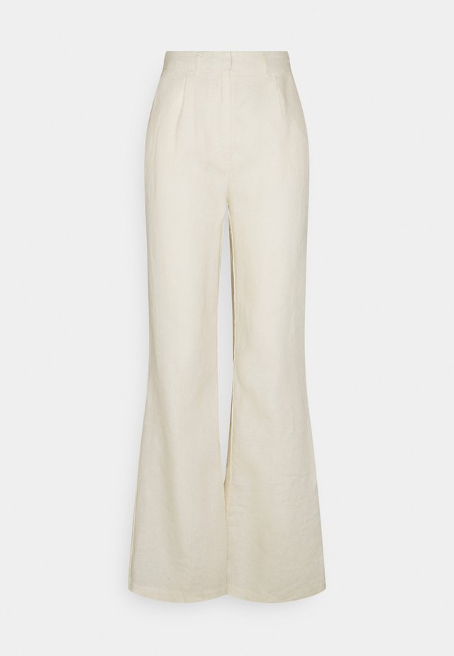 FLARED PANTS - Bukse - light beige