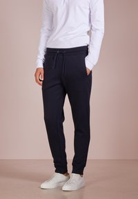 Emporio Armani - PANTALONI - Teplákové kalhoty - blu scuro - 0