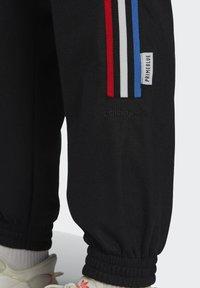 adidas Originals - ADICOLOR TRICOLOR PRIMEBLUE TRACKSUIT BOTTOMS - Tracksuit bottoms - black - 4