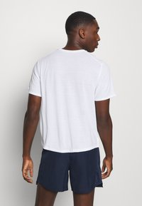 Nike Performance - MILER  - Basic T-shirt - white/silver - 2