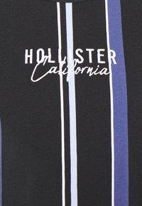Hollister Co. - STRIPE LOGO - T-shirt con stampa - black - 2