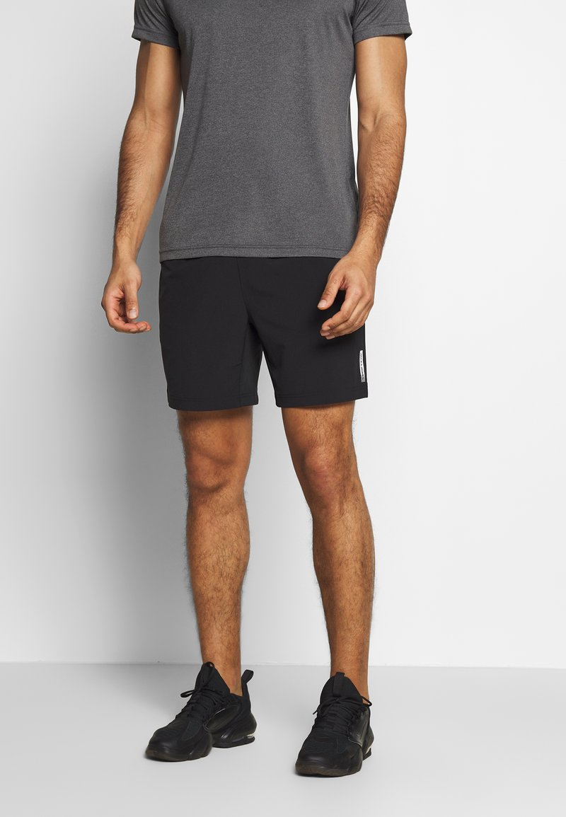 Jack & Jones Performance - JCOZWOVEN - Pantalón corto de deporte - black