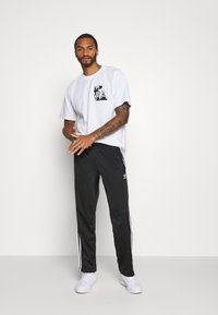 adidas Originals - Tracksuit bottoms - black/white - 1