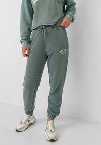 Stradivarius - Tracksuit bottoms - mottled teal - 0