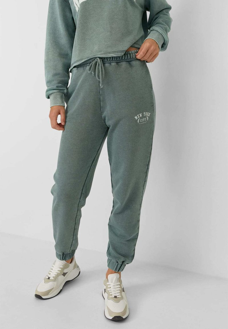 Stradivarius - Tracksuit bottoms - mottled teal