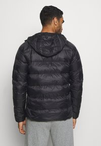 Puma - PWRWARM PACKLITE JACKET - Down jacket - black - 2