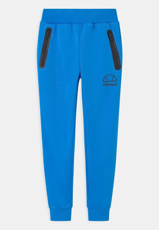 DESTRO UNISEX - Pantalon de survêtement - neon blue