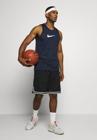 Nike Performance - DRY CROSSOVER - Sports shirt - obsidian/white - 1
