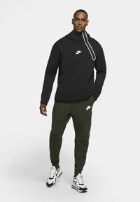 Nike Sportswear - Tracksuit bottoms - sequoia/black - 0