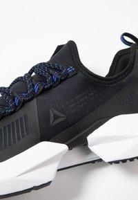Reebok - SOLE FURY TS - Zapatillas de entrenamiento - black/white - 5