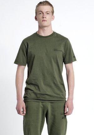 T-shirt med print - olive night