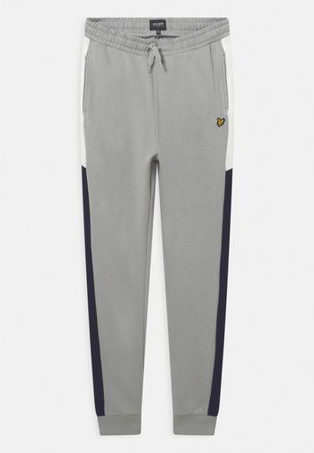 CUT AND SEW - Tracksuit bottoms - high rise