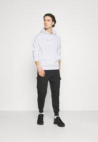 Nike Sportswear - COURT HOODIE - Sweatshirt - white - 1