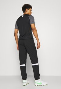Nike Performance - PANT - Pantalon de survêtement - black/white - 2