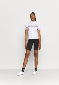 Gore Wear - HAKKA WOMENS - Tights - black/hibiscus pink - 1