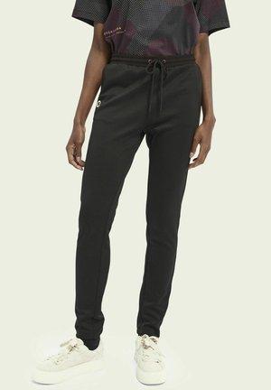 SLIM-LEG - Tracksuit bottoms - black