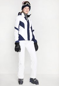 Kjus - WOMEN FORMULA PANTS - Snow pants - white - 1