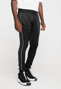 Night Addict - Pantaloni sportivi - black - 0