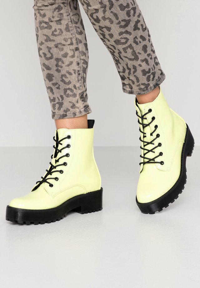 Platform ankle boots - neon yellow