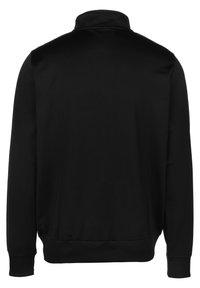 Umbro - TAPED TRACK  - Training jacket - black - 1