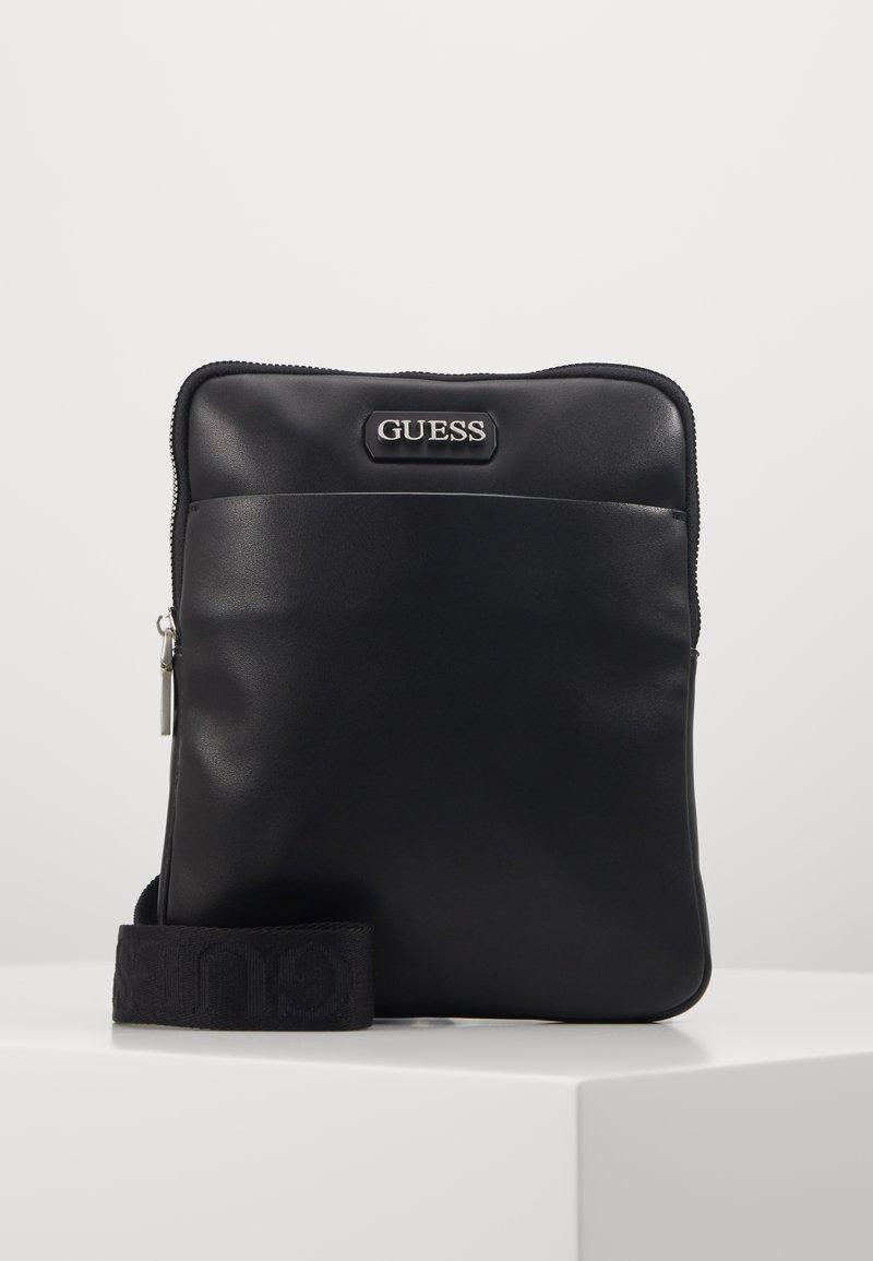 Guess - DAN MINI FLAT CROSSBODY - Across body bag - black