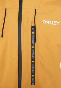 Oakley - GUNN SHELL - Snowboard jacket - gold yellow - 11