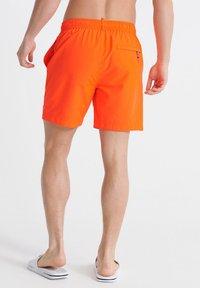 Superdry - WATERPOLO - Swimming shorts - havana orange - 1