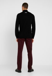 Tommy Hilfiger - DENTON - Trousers - red - 2