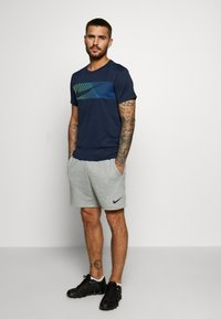 Nike Performance - Print T-shirt - obsidian/white - 1
