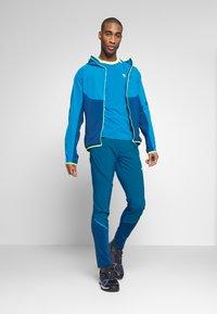 Dynafit - TRANSALPER HYBRID - Spodnie materiałowe - mykonos blue - 1