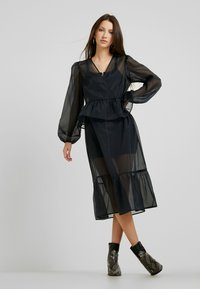 Monki - JENNIFER DRESS - Day dress - organza black - 0