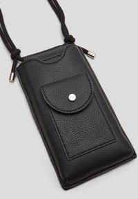 s.Oliver - Phone case - black - 6