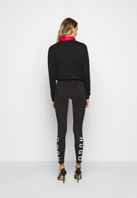 HUGO - Leggings - Trousers - black - 0