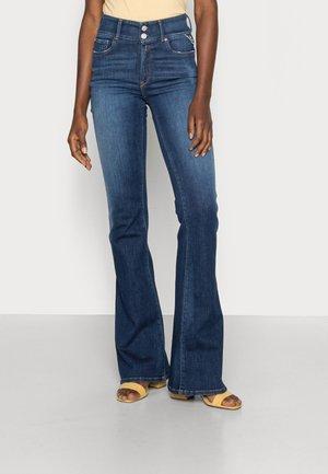 NEWLUZ FLARE PANTS - Flared Jeans - medium blue