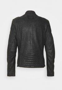 Tigha - STIGO - Leather jacket - black stone wash - 1