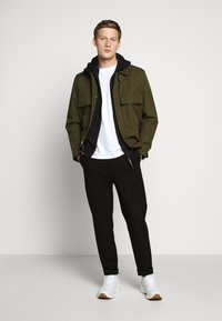 C.P. Company - HOODED OPEN DIAGONAL - veste en sweat zippée - black - 1