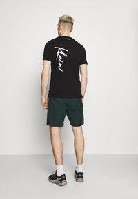 Calvin Klein - SUMMER SCRIPT LOGO - T-shirt con stampa - black - 2