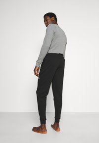 Calvin Klein Underwear - ONE RAW JOGGER - Pyjama bottoms - black - 2