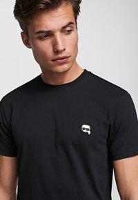 KARL LAGERFELD - IKONIK - Basic T-shirt - black - 4