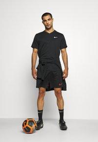 Nike Performance - SHORT - Sports shorts - black/bright crimson - 1