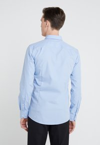HUGO - ELISHA EXTRA SLIM FIT - Kostymskjorta - light blue - 2