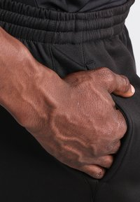 Joma - NILO - Tracksuit bottoms - black - 5