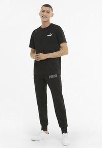 Puma - ESS SMALL LOGO TEE - Basic T-shirt - mottled anthracite - 1