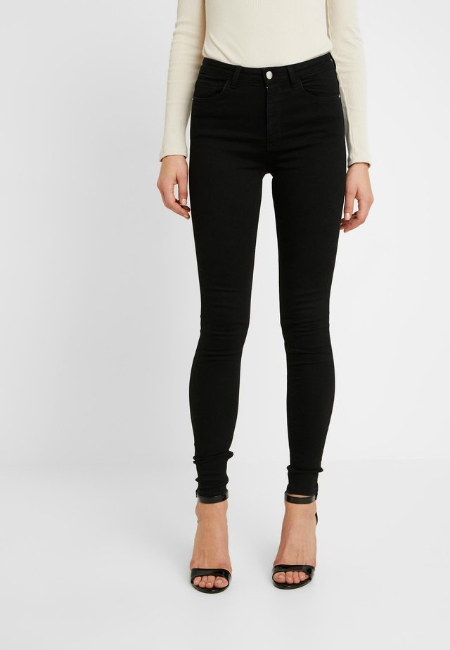 Pamela Reif x NA-KD HIGH WAIST - Jeans Skinny Fit - black