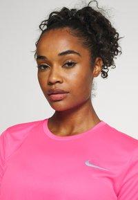 Nike Performance - MILER - Camiseta estampada - pink glow/silver - 4