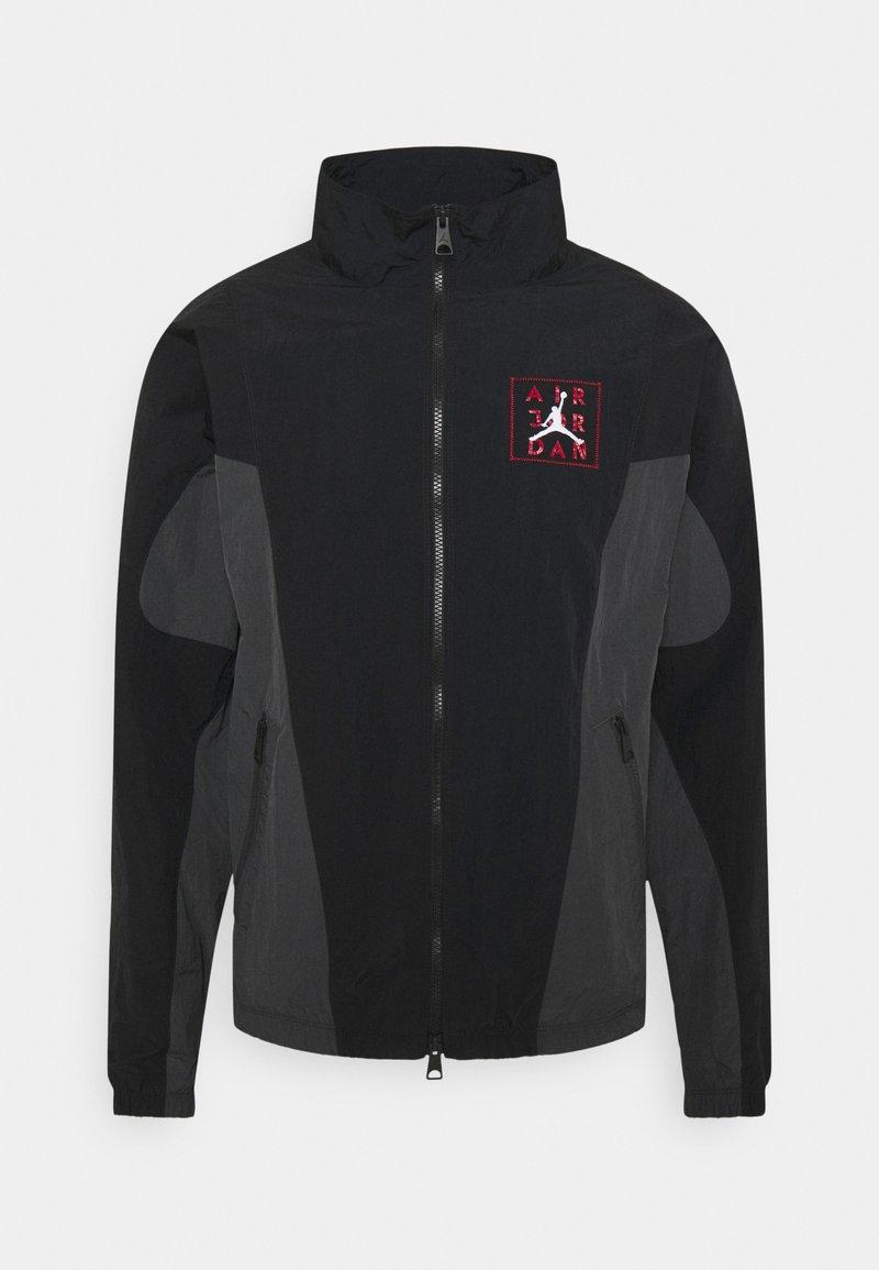 Jordan - Training jacket - black/dark smoke grey