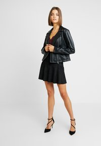 Pieces - PCRIONE BIKER ZIP JACKET - Faux leather jacket - black - 1