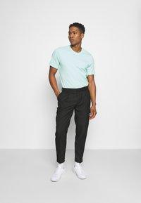 Topman - SMART CHECK TAPER - Cargo trousers - black - 1