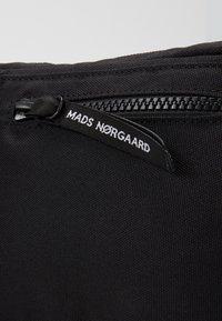 Mads Nørgaard - BEL AIR RECY CARNI UNISEX - Bum bag - black - 5