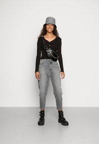 Vero Moda - VMANITA  V-NECK BUTTONS - Long sleeved top - black - 1